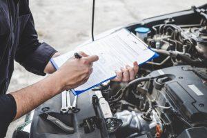 man repairing a honda car